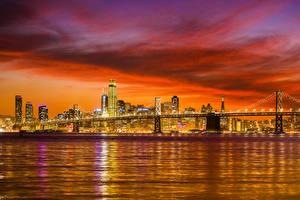 Bilder Vereinigte Staaten Gebäude Flusse Brücken Sonnenaufgänge und Sonnenuntergänge Abend San Francisco