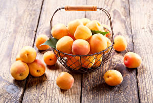 Pictures Apricot Many Wood planks Wicker basket Food