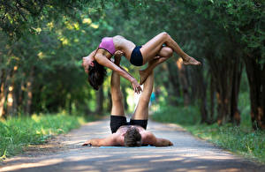 Photo Gymnastics Men 2 Brown haired Workout young woman Sport