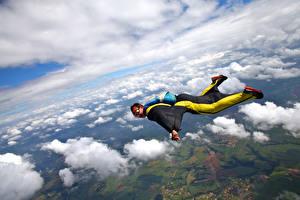 Desktop wallpapers Parachuting skydiving Men Flight Clouds Uniform Sport