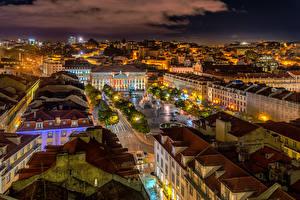 Tapety na pulpit Portugalia Budynek Dachy Noc Plac Lissabon Miasta