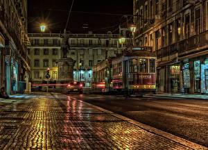 Tapety na pulpit Portugalia Domy Pomnik Ulica Noc Latarnia uliczna Lissabon miasto