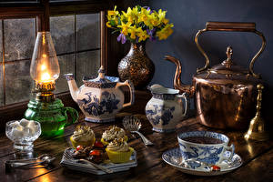 Wallpaper Still-life Bouquets Narcissus Paraffin lamp Kettle Tea Little cakes Cup Sugar Vase Food