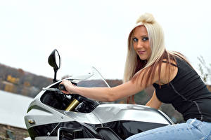 Photo Blonde girl Motorcyclist Glance Smile young woman