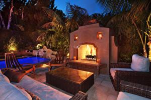 Photo Evening Swimming bath Fireplace Armchair Cities