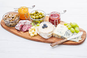 Pictures Knife Olive Sausage Cheese Powidl Mushrooms Grapes Cutting board Jar Food