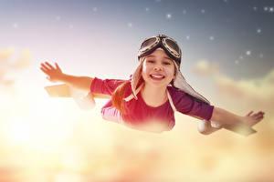 Pictures Little girls Flight Eyeglasses Hands Smile Children