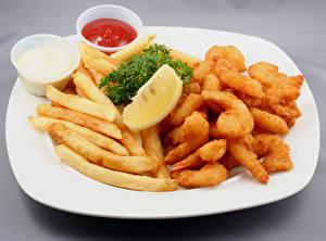 Hintergrundbilder Fleischwaren Fritten Zitrone Teller Ketchup
