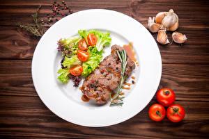 Bilder Fleischwaren Tomate Knoblauch Gemüse Teller