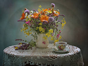 Images Still-life Bouquets Lilies Cornflowers Matricaria Lathyrus odoratus Drinks Vase Cup Table flower