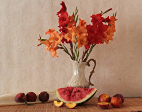 Photo Still-life Gladioluses Watermelons Peaches Vase Flowers Food