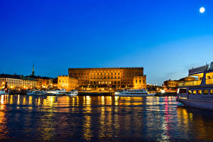 Picture Stockholm Sweden Houses Pier Riverboat Palace Bay Night time Royal Palace Cities