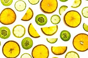 Bilder Limette Orange Frucht Textur Weißer hintergrund Lebensmittel