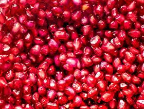 Fotos Granatapfel Textur Großansicht Getreide Lebensmittel