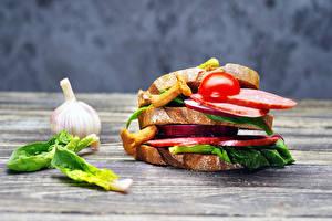 Fotos Sandwich Gemüse Knoblauch Brot Wurst