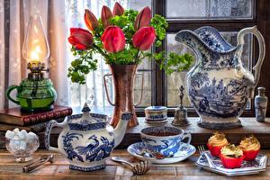 Pictures Still-life Tulips Kerosene lamp Tea Kettle Little cakes Vase Jug container Cup Sugar Food Flowers
