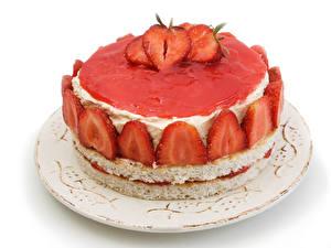 Fotos Süßware Torte Erdbeeren Weißer hintergrund Teller