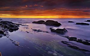 Fotos Landschaftsfotografie Meer Sonnenaufgänge und Sonnenuntergänge Steine Himmel Natur