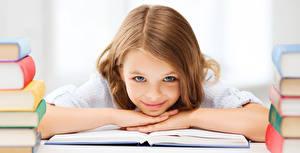 Photo School Little girls Smile Staring Book Brown haired Hair Children