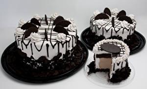 Fotos Süßigkeiten Torte Schokolade Grauer Hintergrund Design Drei 3