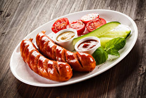 Wallpapers Vienna sausage Cucumbers Tomatoes Plate Ketchup