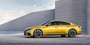 Bilder Volkswagen Seitlich Gelb Arteon R line Autos
