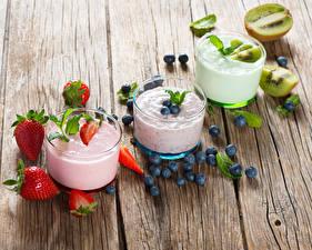 Images Yogurt Strawberry Blueberries Chinese gooseberry Wood planks Highball glass Three 3 Food