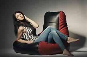 Wallpapers Armchair Brunette girl Sitting Jeans Glance Girls
