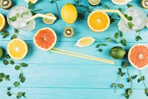 Fotos Zitrusfrüchte Zitrone Grapefruit Essstäbchen Trinkglas Bretter