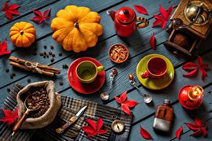 Photo Coffee Cinnamon Pumpkin Candles Wood planks Grain Cup Foliage Spoon Food