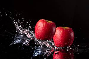 Image Apples Closeup Black background Water splash Food