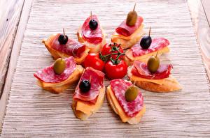 Fotos Fast food Butterbrot Wurst Oliven Tomate Schinken