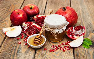 Picture Honey Apples Pomegranate Wood planks Jar Grain Food