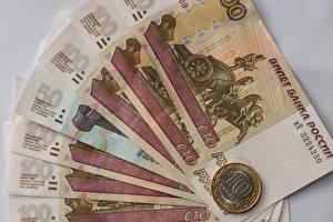 Bakgrundsbilder på skrivbordet Pengar Sedlar Ett mynt Rubel Närbild 100 10