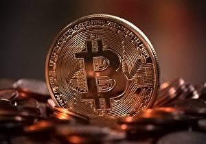 Bakgrundsbilder på skrivbordet Pengar Ett mynt Närbild Bitcoin