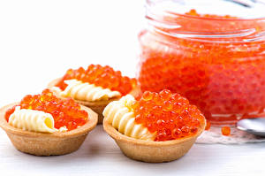 Pictures Seafoods Caviar White background Oil Red Grain Tartlets Food