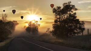 Picture Sunrise and sunset Roads Balloon (aeronautics) Trees Fog Nature