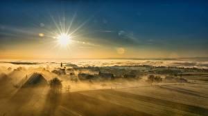 Bilder Sonnenaufgänge und Sonnenuntergänge Landschaftsfotografie Himmel Sonne Dorf Nebel Natur