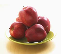 Bilder Äpfel Großansicht Weißer hintergrund Teller Rot Lebensmittel