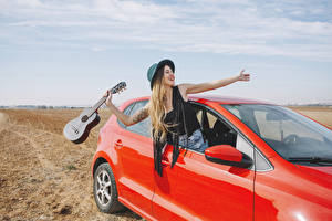 Photo Blonde girl Hat Guitar Hands Happy Girls