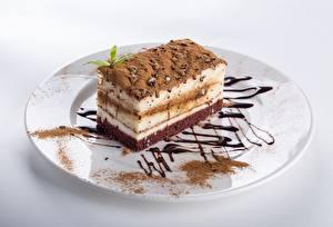 Bilder Torte Stück Teller Kakaopulver Lebensmittel