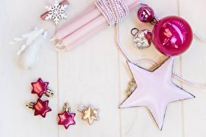 Fotos Kerzen Neujahr Bretter Schneeflocken Kugeln Kleine Sterne