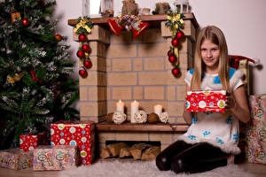 Images New year Candles Fireplace New Year tree Gifts Scarf Little girls Sitting Children