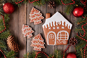 Photo Christmas Cookies Building Wood planks Branches Pine cone Balls Design Christmas tree Food