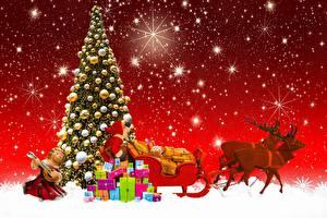 Fotos Neujahr Feiertage Hirsche Geschenke Weihnachtsmann Schlitten Tannenbaum