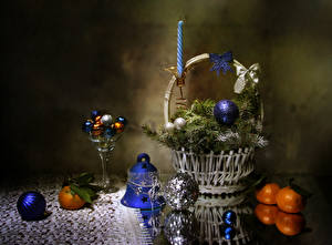 Images Christmas Still-life Mandarine Candy Wicker basket Branches Balls Bells Food