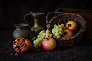 Fotos Weintraube Granatapfel Kanne Weidenkorb