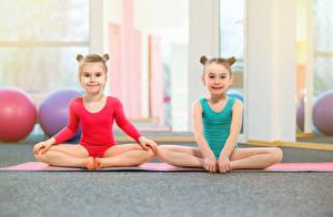 Pictures Gymnastics Little girls Two Uniform Sit Staring Children