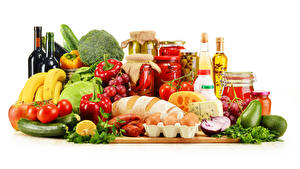 Photo Still-life Vegetables Fruit Bread Cheese Grapes Avocado Bell pepper Tomatoes White background Bottles Jar Egg Food
