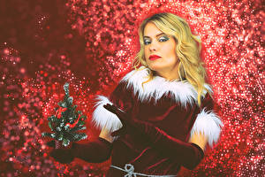 Picture New year Blonde girl Uniform Christmas tree Glove Glance female